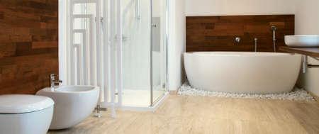 Modern bathroom african style bathroom with exotic wood Foto de archivo