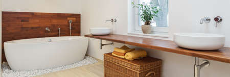 travertine house: Interior of bathroom in african style - panorama Stock Photo