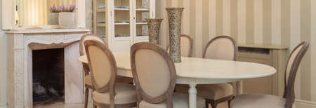 Panorama of cosy dining room with a fireplace photo