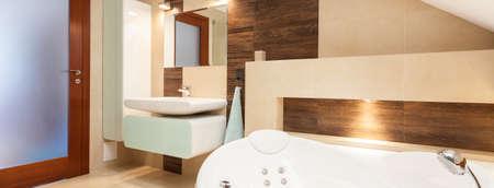 Panoramic view of stylish designed bathroom in elegant house photo