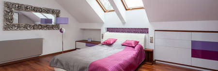 Modern bedroom in the attic of contemporary house photo