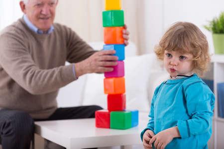 kindergartner: Image of kindergartner and colorful building blocks