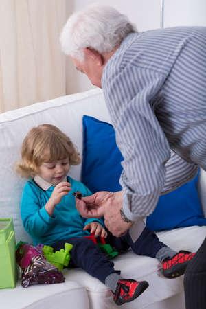 kindergartner: Grandparent and little grandson playing together at home