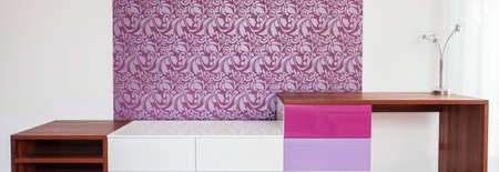 commode: Modern commode in stylish violet and white room