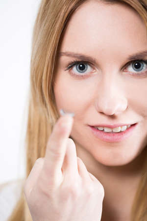 hyperopia: Portrait of young beautiful woman with contact lens