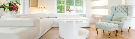 luxury living room: Panoramic photo of luxury bright and spacious living room Stock Photo