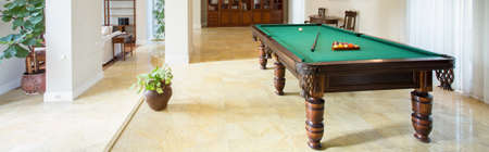 parlour games: Billiard table in living room in luxury apartment, panorama