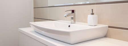 vessel sink: Panorama of silver tap in white elegant bathroom