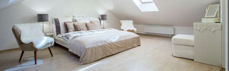 Double bed with a lot of cushions in luxury bedroom