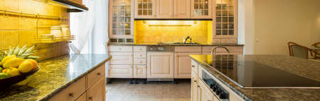 Panorama of granitic countertop in luxury kitchen