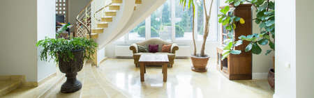 manor house: Vintage luxury mansion interior with spiral stairs, panorama Stock Photo