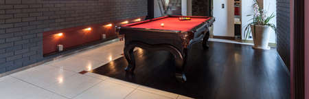 billiards room: Contemporary designed interior with a snooker table, panorama