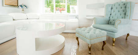 front room: Exclusive comfortable chair in bright room - panorama Stock Photo