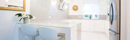 kitchen countertops: Panoramic view of designer white kitchen interior Stock Photo