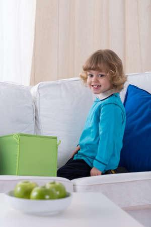 kindergartner: Cute blonde toddler showing his milk teeth Stock Photo