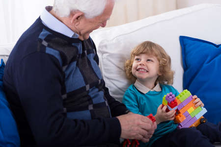 grandkid: Happy grandfather and grandkid spending time together