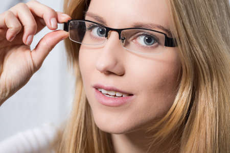 Young beautiful blond woman in new glasses Stock Photo