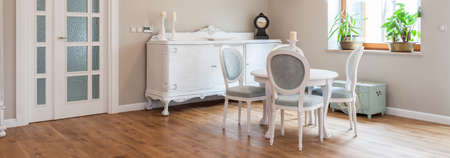 dining table and chairs: Elegant white wooden table and chairs in dining room