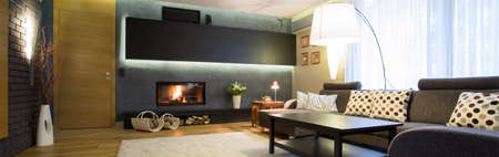 warm color: Panoramic view of elegant and modern family room Stock Photo