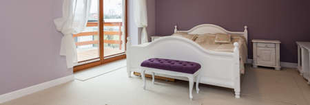 Panorama of bedroom with purple color on wall photo