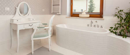 White spacious bathroom with a dressing table, panorama