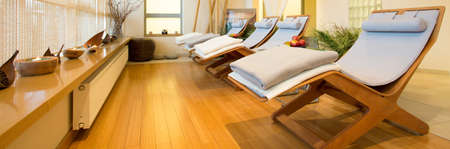 Panorama of loungers in cozy spa room