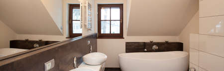 Panoramic view of white and black bathroom interior photo