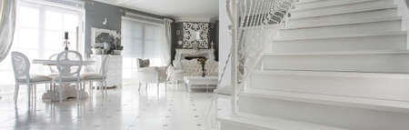 Panorama of luxury sophisitcated interior with marble stairs Stock Photo