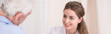 color therapist: Close-up of beautiful female carer taking care about her older ward Stock Photo