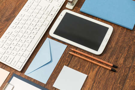 desk tidy: Close-up of clean office desk with keyboard and tablet