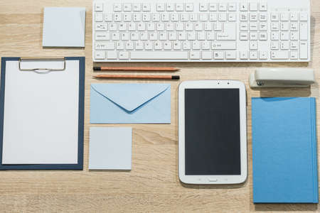 desk tidy: Precisely arranged wooden office desk with tablet and notebook Stock Photo