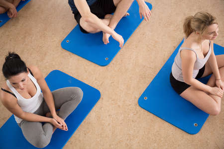 floor mat: Gym people sitting on exercise floor mat