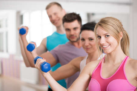 flexion: Portrait of group of smiling fitness instructors