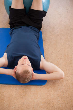 laying abs exercise: Man working out on the exercise floor mat