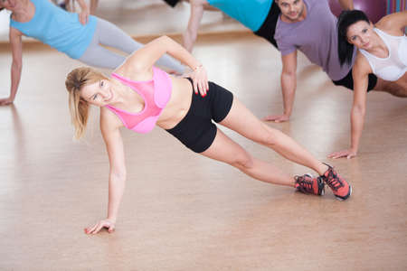 fitness center: Close-up of fitness instructor showing advanced exercise Stock Photo