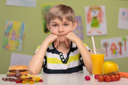 overweight kid: Hard decision - fast food or healthy food