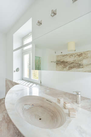 expensive granite: View of granitic sink in expensive bathroom Stock Photo