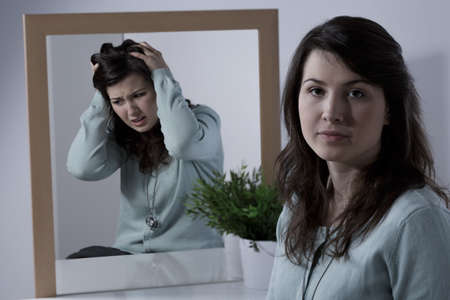 Young emotionally unstable woman with bipolar disorder Stockfoto