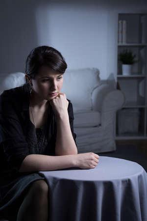 widow: Despair widow woman sitting alone in room
