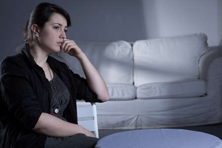heartbroken: Heartbroken woman after breakup spending evening alone Stock Photo