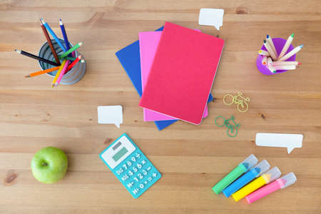 marker pen: Colorful school supplies on the wooden desk Stock Photo