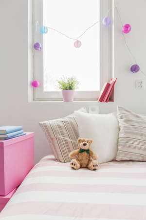 Cute white and rose girls room interior