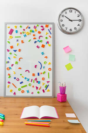interior room: Magnetic alphabet on the board in childs room