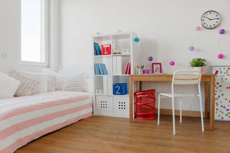 Bookcase: Interior of designed beauty room for schoolgirl Stock Photo