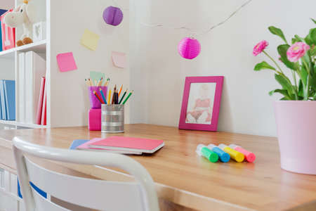 workspace: Stationery on the desk in kids room