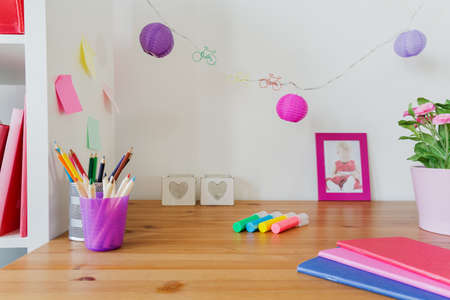 Color school accessories on the desk of little girl Stock Photo