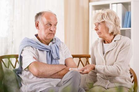 refusing: Photo of senior man refusing taking medicament
