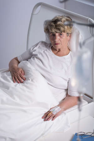 Retiree being on a drip in hospital
