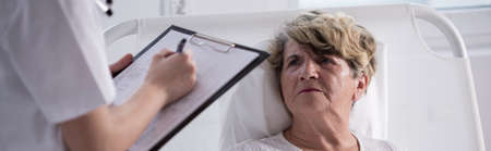 Unhappy senior woman staying in hospital - panorama