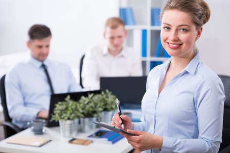 Image of attractive businesswoman and her co-workers Stock Photo